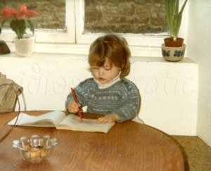 Young Girl Scribbling at Table