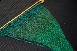 Can You Guess What it is Yet? - Green Triangular Piece of Knitting in Stocking and Moss Stitch
