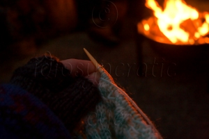Knitting in the Dark Around a Fire Wearing Gloves and a Big Jumper