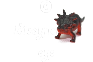 Red Dinosaur Toy on White Background