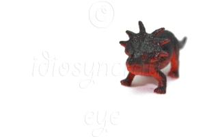 Red Dinosaur Toy on White Background