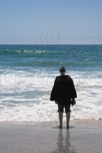 A Colour Image of a Sunny Day on a Beach with a Black and White Person - A Visual Metaphor for Depression