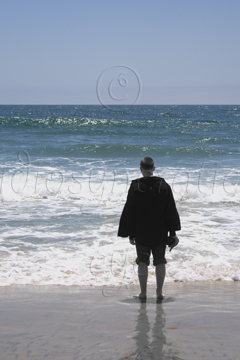 A Colour Image of a Sunshiney Day on a Beach with a Black and White Person - A Visual Metaphor for Depression