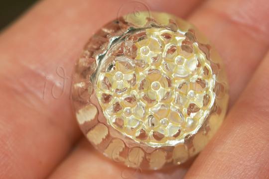 Textured translucent plastic button